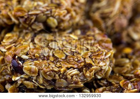 Stack of fresh baked oatmeal and fruit flapjacks close up