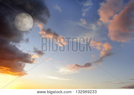 Moon clouds skies is a vibrant surreal fantasy like cloudscape with the ethereal heavenly full moon rising among the vibrant wispy colorful cloudscape.