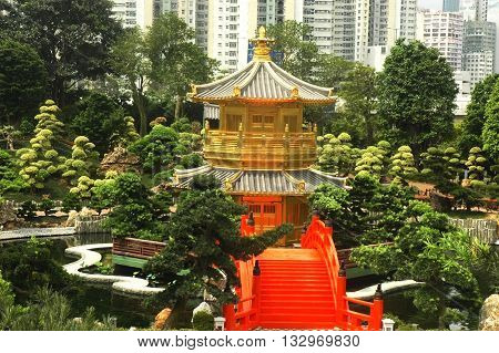 oriental golden pavilion of Chi Lin Nunnery and Chinese garden landmark in Hong Kong .