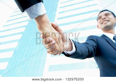 Handshake of businessmen - business partner greeting & dealing concepts
