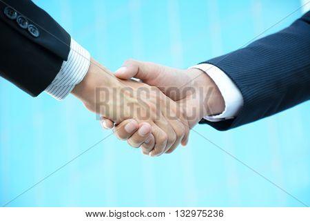 Handshake of businessmen - business partner greeting & dealing concepts