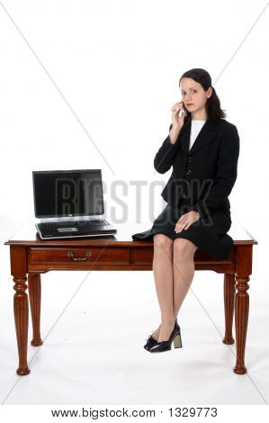 Female Executive Sitting On Her Desk (Ss)