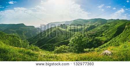 Beautiful landscape with green mountains and magnificent cloudy sky. Exploring Armenia