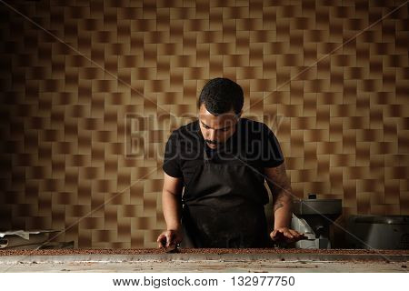 Black Man Cooks Chocolate Cakes In His Professional Artisan Confectionery Checking Condition Of Melt