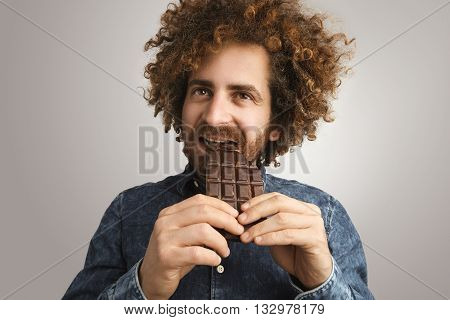 Young Happy Bearded Man With Healthy Skin And Curly Hair Dreamely Bites Organic Freshly Baked Chocol
