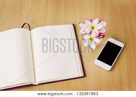 Smartphone And Blank Note Book Or Diary In Relax Mood, Empty Note Book Or Diary With Frangipani Or P