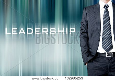 Leadership Sign On Motion Blur Abstract Background With Standing Businessman