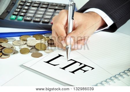 Businessman hand with pen pointing to LFT (Long Term Equity Fund) sign on the paper