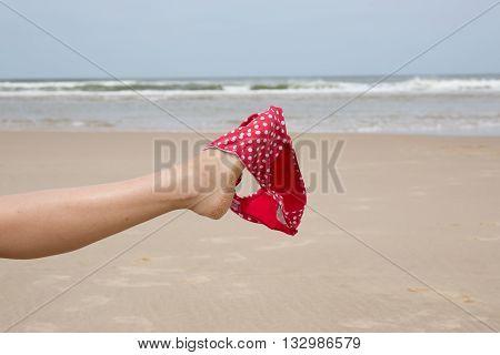 Leg On Beach Holding Bikini On Summer