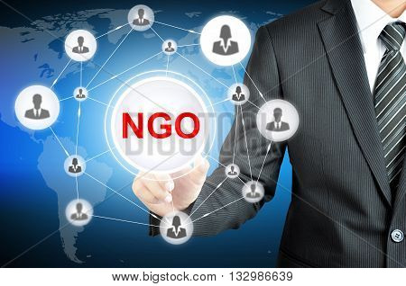Businessman Pointing On Ngo (non-governmental Organization) Sign On Virtual Screen With People Icons