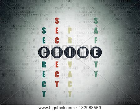 Safety concept: Painted black word Crime in solving Crossword Puzzle on Digital Data Paper background