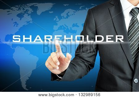Businessman Pointing To Shareholders Sign On Virtual Screen