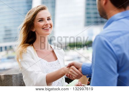 Two people, man and woman give handshake after agreement.