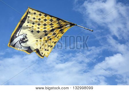 Traditional Italian Festival With Flag Throwers.flags On The Blue Sky
