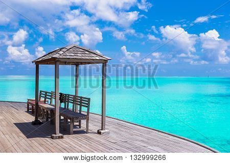 Beautiful tropical view of perfect ideal island, wooden jetty and turquiose water