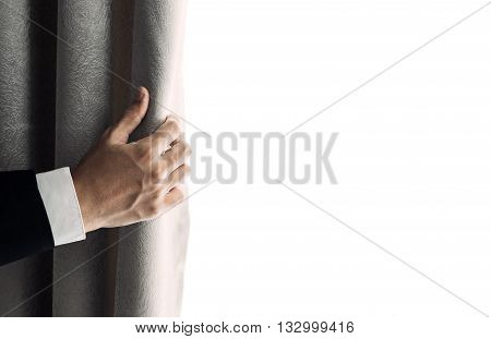 Businessman hand opening curtain, receiving bright light in the morning. with copy space