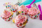 Pink cupcakes and cookware. Birthday cupcakes. Homemade cupcake. Sweet dessert. Sweet pastry. Gourmet cupcakes. Sweet cupcake. poster