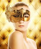 Beautiful woman in carnival mask over abstract background poster