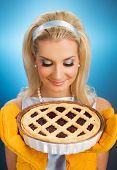 Beautiful woman holding hot italian pie. Retro stylized portrait