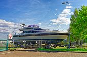 Yacht in the street of Ventspils in Latvia. Ventspils is a city in the Courland region of Latvia. Latvia is one of the Baltic countries. poster