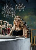 young blond woman wearing crown in fairy luxury interior with empty antique frames total wealth, magic rich concept poster