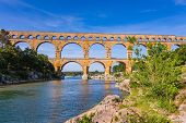 Three-storied aqueduct of Pont du Gard - the highest in Europe. The bridge was built at the time of Roman Empire on river Gardon. Provence, spring sunny day poster