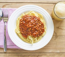 Dish of Italian spaghetti with rich tomato based Bolognaise sauce