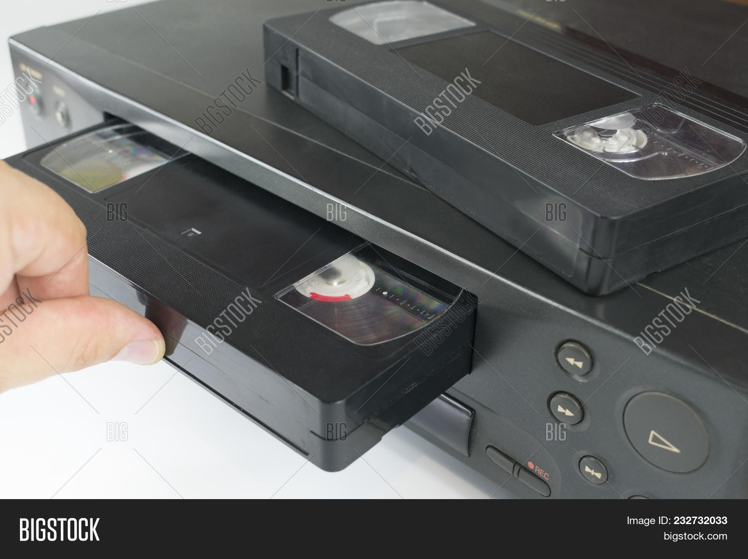 Vhs Videocassette Is Put Into The Video Recorder To Watch Another Cassette