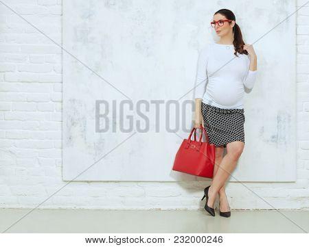 Fashion portrait of pregnant businesswoman - pregnant woman in business casual.
