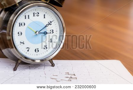 Time Counting Down On Alarm Clock To Palce The Last Jigsaw