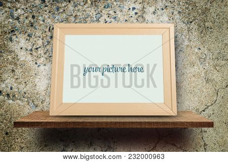 Empty Blank Photo Frame On Rock Texture Wall For Photo Mock Up