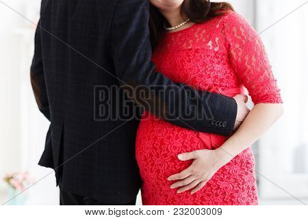 Pregnant With A Her Husband Holding Together