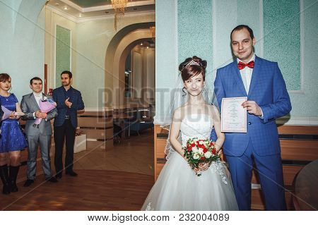 Russia, Kirov - November 24, 2017: Bride, Groom, Relatives And Guests During Photoshoot In The Regis