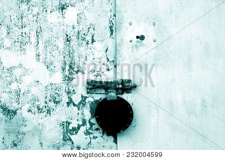 Old Padlock On Metal Gate In Cyan Color. Abstract Background And Texture.