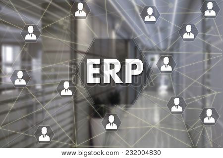 Enterprise Resource Planning. Erp  On The Touch Screen With A Blur Background Of The Office.the Conc