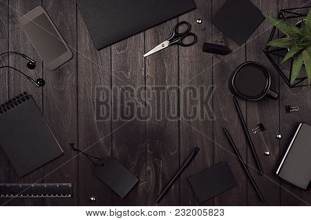 Blank Black Corporate Stationery As Work Place With Copy Space On Dark Stylish Wood Background. Bran
