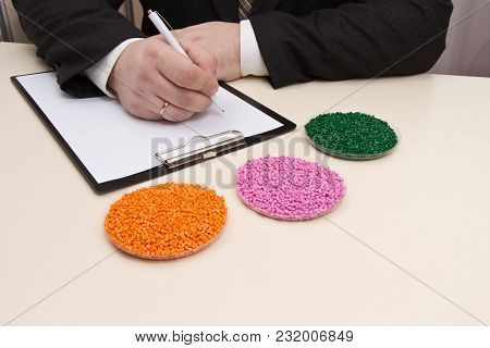 The Businessman Signs A Contract For The Supply Of Plastic Granules For The Industry.plastic Raw Mat