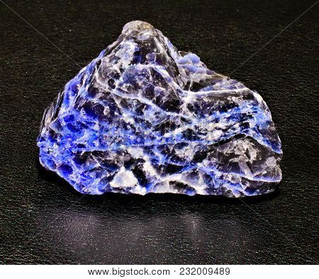 Blue Black Sodalite Mineral Stone On Black Background