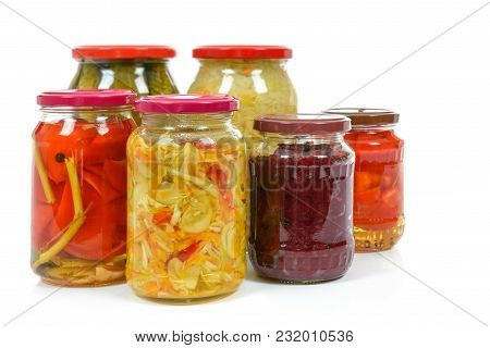 Jars With Variety Of Homemade Pickled Vegetables Isolated On A White Background.