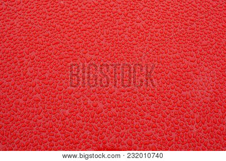 Close-up Red Metal With Water Drops Texture Background.
