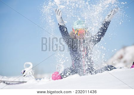 Image Of Sports Woman Sitting In Snowdrift, Snow-throwing In Winter