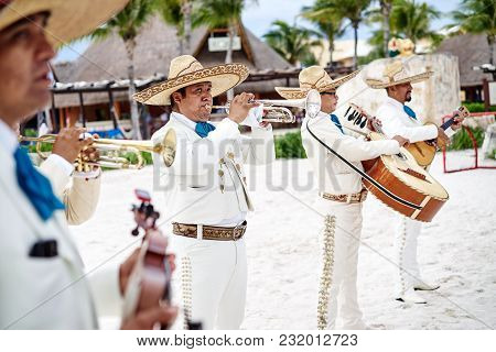 Cancun / Mexico - June 5, 2015: Traditional Mexican Music Band Playing Trumpet, Classical Guitar In