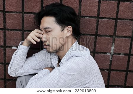 Anxious Stressed Young Asian Business Man Suffering From Severe Depression. Thoughtful Concept