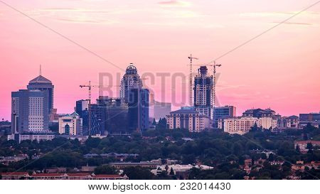 Johannesburg,south Africa, March 15,2018: Tall Buildings Of Central Business District In Evening Lig