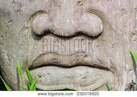 Closeup Of A Big Head Statue Made Of Stone