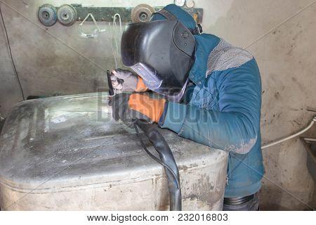 Argon Aluminum Welding. Man Professional Welds Aluminum