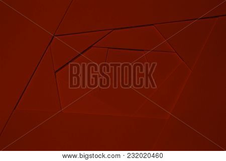 Abstract Geometric Background In Dark Tones From Sheets Of Thick Red Paper, Cardboard. Suitable As D