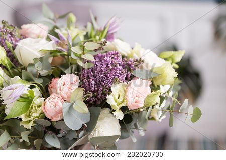 Sunny Spring Morning In Living Room. Beautiful Luxury Bouquet Of Mixed Flowers In Glass Vase. The Wo