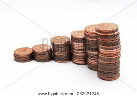 Stack Of Coins, One Penny Coins Isolated On White