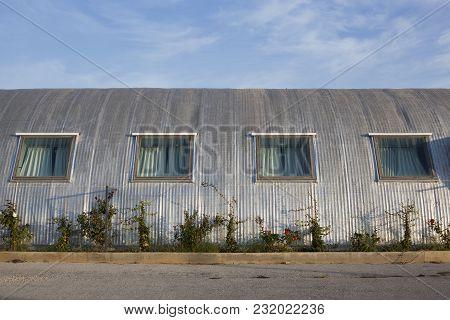 Μetal Construction Of A Building With Four Windows.